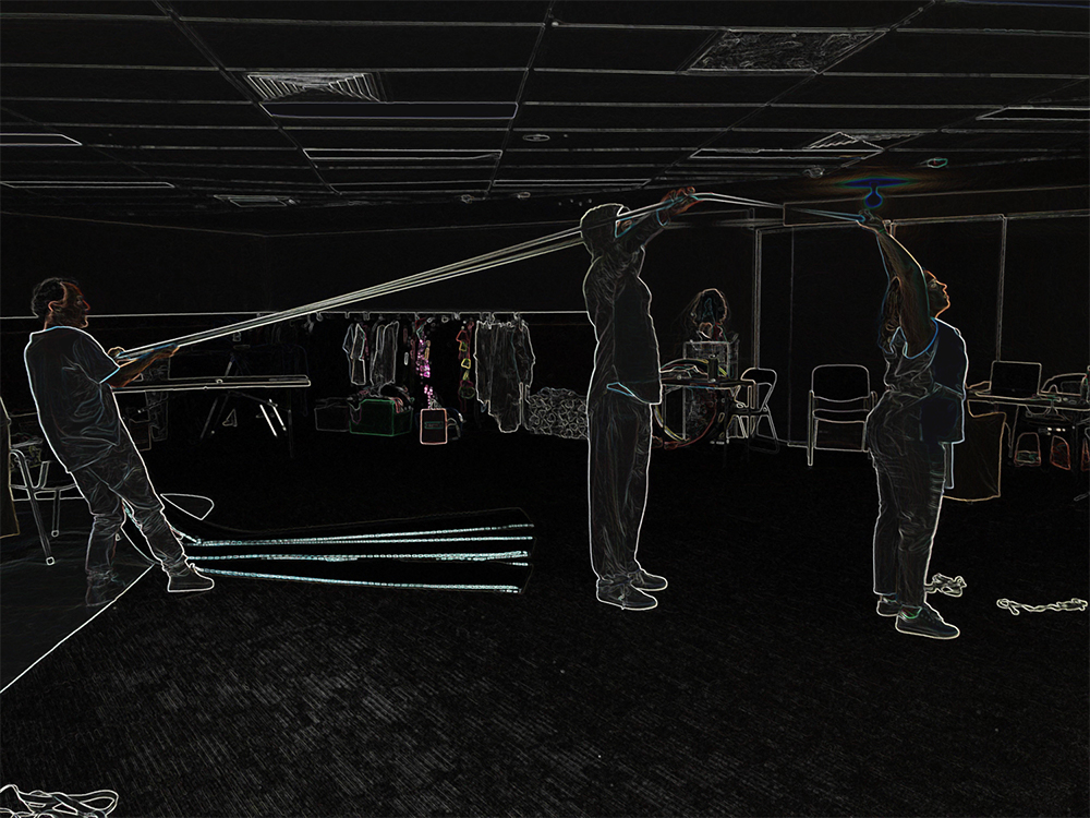 A black image with neon outline of people, furniture and room interiors